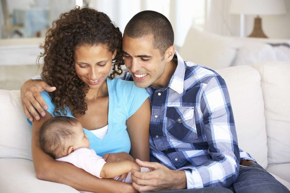 Happy mixed race family with baby